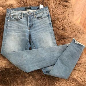 Banana Republic Skinny Jeans with raw hem. Size 27